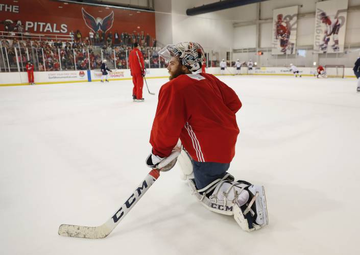 55346be092e Washington Capitals goaltender Braden Holtby (70) kneels on the ice during  practice in Arlington