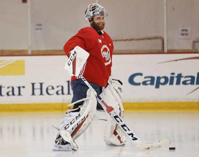 16ebc981c33 Washington Capitals goaltender Braden Holtby smiles as he takes the ice  during team practice in Arlington