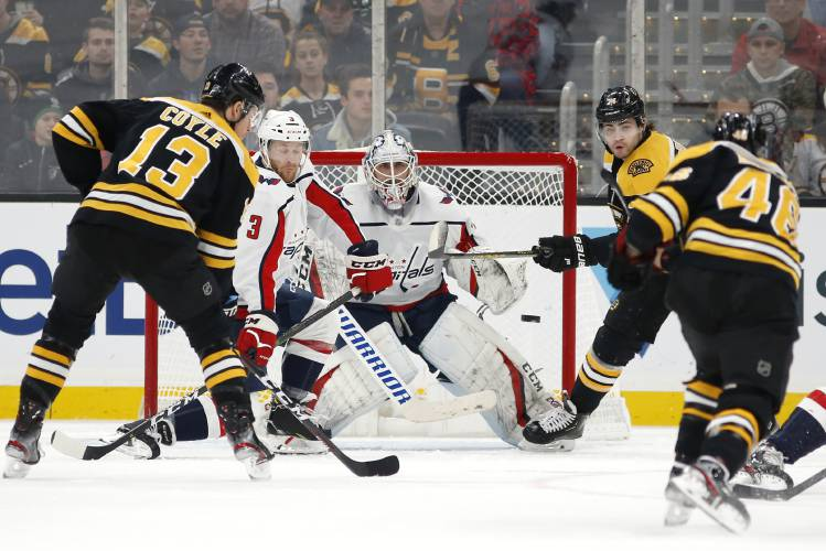 Bruins score 4 in 1st to chase Holtby, beat Capitals 7-3