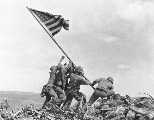 In This 1945 Photo US Marines Of The 28th Regiment 5th Division Raise American Flag Atop Mount Suribachi Iwo Jima Japan Joe Rosenthal AP File