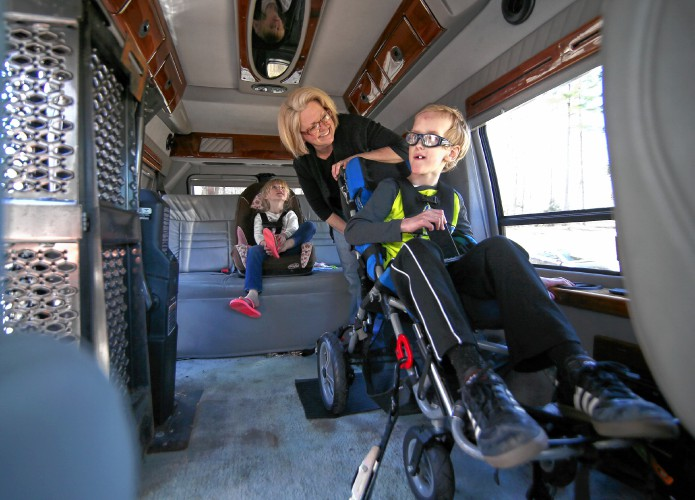 Becky Buchholz Straps In Her Son Kooper Before Heading Out The Van Family Received From Ascentrias Good News Garage Thursday