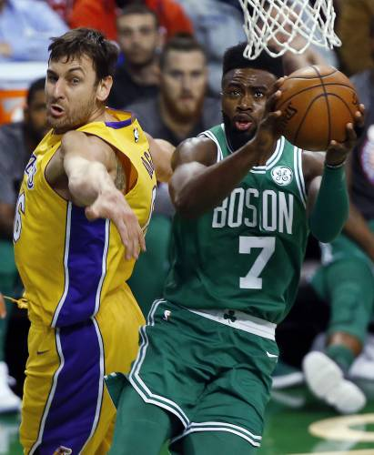 2ecbe5671 Boston Celtics  Jaylen Brown (7) goes to the basket past Los Angeles Lakers   Andrew Bogut during the first quarter of an NBA basketball game in Boston  on ...