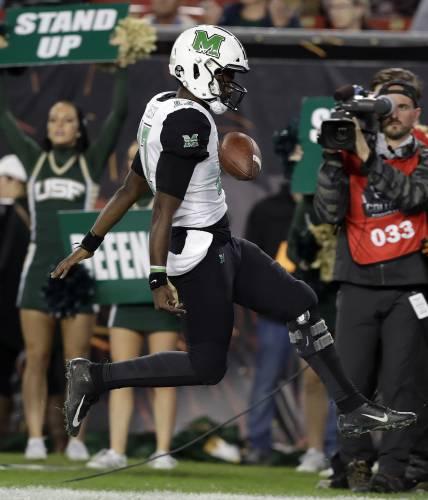 da4a30a40 Marshall quarterback Isaiah Green (17) celebrates his 11-yard touchdown run  against South Florida during the first half of the Gasparilla Bowl NCAA  college ...