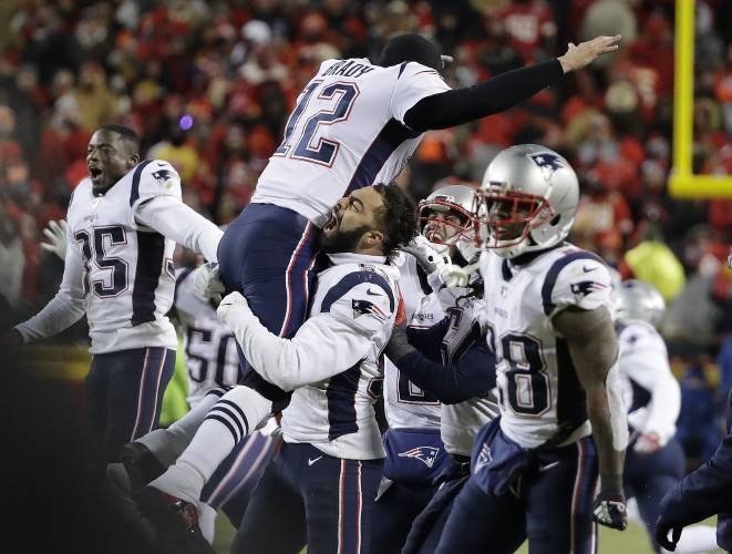 366534a2564 New England Patriots quarterback Tom Brady (12) jumps into the arms of New  England Patriots middle linebacker Kyle Van Noy as they and teammates  celebrate ...