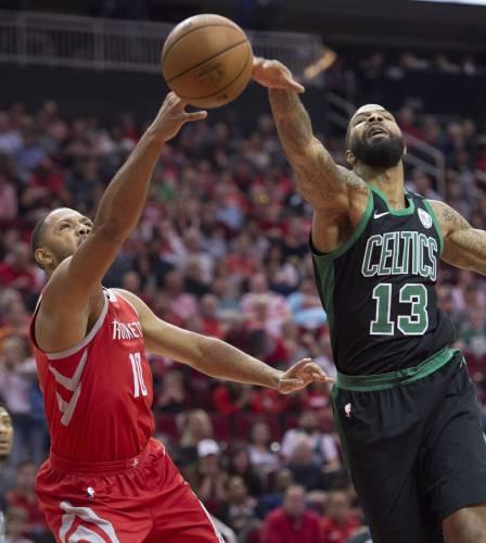 1a681d0b7dcb Boston Celtics forward Marcus Morris (13) blocks the shot of Houston Rockets  guard Eric Gordon (10) during the first half of an NBA basketball game  Saturday ...