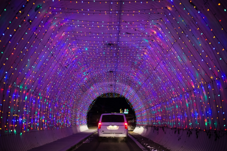 A car passes through an illuminated infield tunnel as it drives along the  2-mile Christmas lights display called Gift of Lights at the New Hampshire  Motor ... - PHOTOS: Gift Of Lights At NHMS