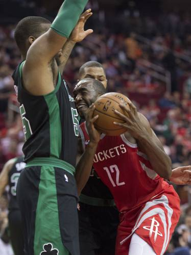 ef4d9947ea9f Houston Rockets forward Luc Mbah a Moute (12) tries to drive to the basket  against Boston Celtics center Greg Monroe (55) during the first half of an  NBA ...