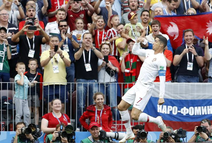 Portugal s Cristiano Ronaldo celebrates after scoring his side s opening  goal during the group B match between Portugal and Morocco at the 2018 soccer  World ... 1ff41830d