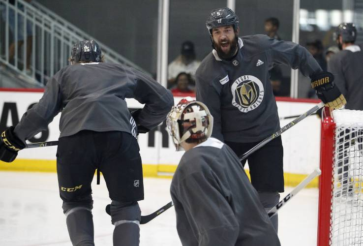 af941bd6e Vegas Golden Knights defenseman Deryk Engelland, right, reacts after a  drill during an NHL hockey practice Wednesday, June 6, 2018, in Las Vegas.