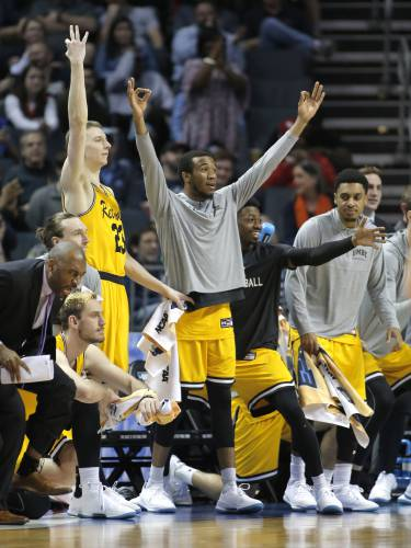 Pembroke Academy graduate Max Curran (23) signals a 3-pointer as fellow UMBC  players celebrate a teammate s basket against Virginia during Friday s  historic ... cea10dd58