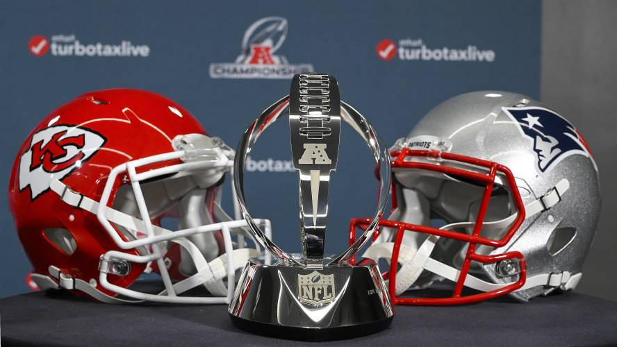 ddf6447b29a The Lamar Hunt Trophy stands between helmets of the Kansas City Chiefs and  the New England Patriots