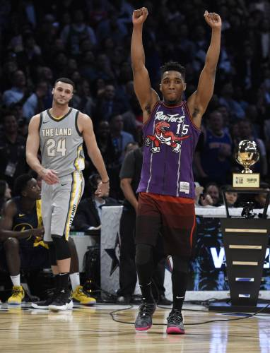 cheap for discount cab98 40896 Mitchell soars to dunk title; Booker sets 3-point record