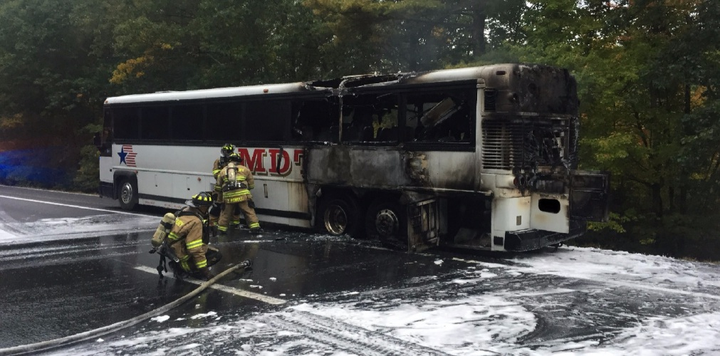 Bus fire snarls traffic for miles on I-93