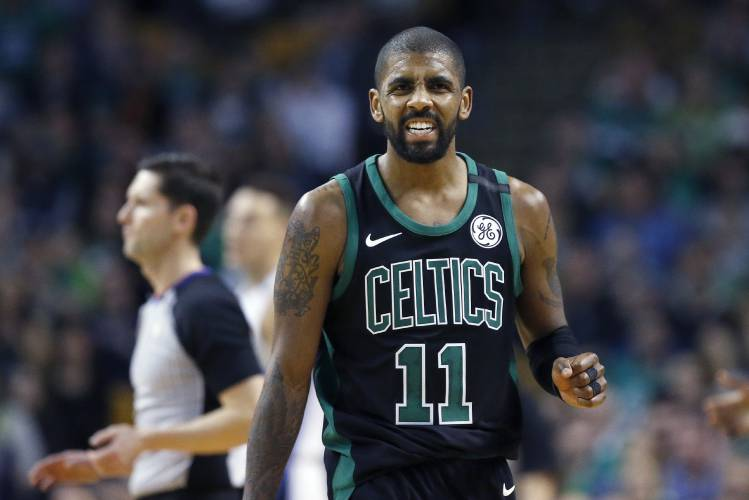 18bc7695c1f4 Kyrie Irving grimaces during a game earlier this season. The All-Star was  ruled out for the playoffs Thursday. AP file