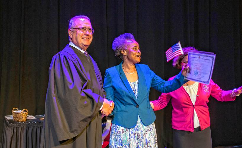 Worth the wait: New citizens sworn in during ceremony at