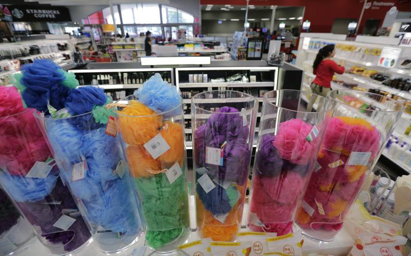 c94f4e76afc In this May 30, 2018, photo, a Target worker stocks product in the updated  cosmetic department at a Target store in San Antonio. Shoppers are changing  the ...